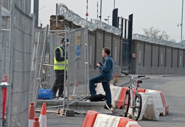 An ex-Ghurka security guard, sub-contracted by G4S, warns a passing photographer to stop taking pictures of the Olympic site or he will call the Police. Apr 2009