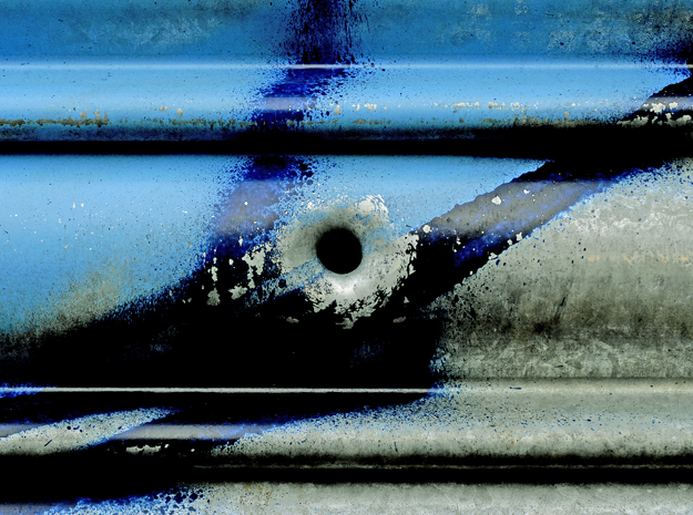 A bullet hole in the metal shutter of a Hackney Marsh sports centre. 2010