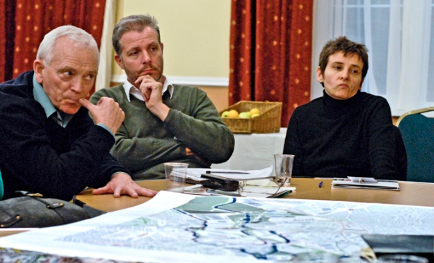 "Sceptical listeners at a ""Your Games, Have Your Say"" event in Hackney. A plan of the site lies open on the table.2006"