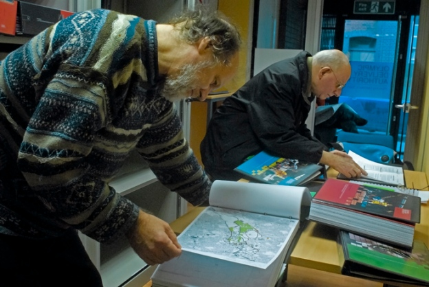Julian Cheyne, a resident of the Clays Lane Housing Estate and a member of Games Monitor, looking at maps from the Olympic Planning Application. Feb 2007