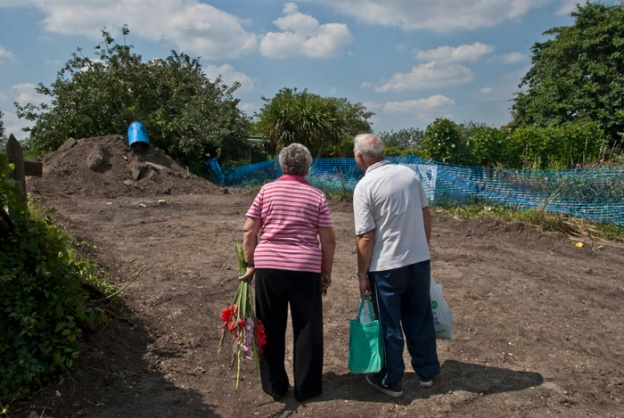 Les & Margaret on their way home staring at a nearby plot which has recently been bulldozed to accomodate a soil test bore hole.  Aug 2007