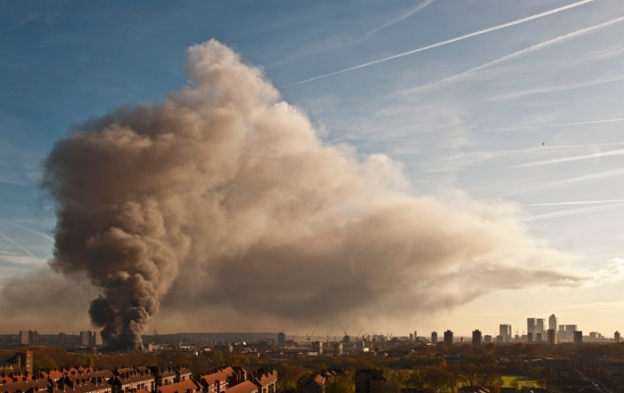 A runaway fire was ignited during demolition of an  old clothes factory within the Olympic construction site at Waterden Road. (The black dot is a Police helicopter.) 12 Nov 2011.