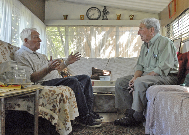 Les and Tom Norris (R) in Tom's shed at Manor Gardens which he left as seen here when evicted by the Olympics.