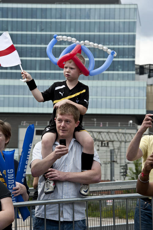 Converts to global branding waiting for the torch relay circus in Stratford. July 2012
