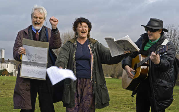 Lawrence Wortley, Katy Andrews and Rosemary Johnson of the Lammas Lands Defence Committee celebrating the defeat of the Olympic Delivery Authority who were refused planning permission (temporarily) to acquire public land for relocating Manor Gardens Allotmentsto Marsh Lane Fields. Feb 2007