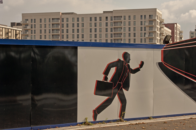 Running to catch up. Chobham Manor hoarding. Olympic Park. Oct 2014